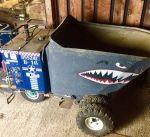 Ride on hydraulic wheelbarrow